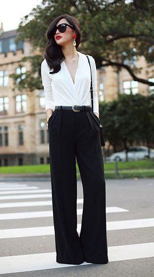 เสื้อขาว กางเกงบานสีดำ