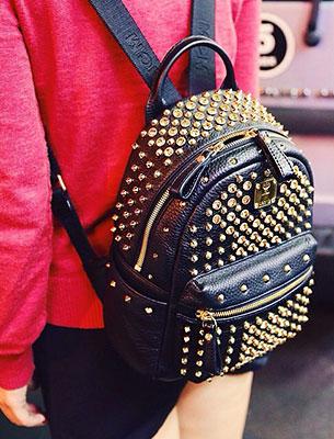 กระเป๋า MCM หนัง หนามสีทอง