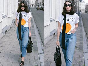 เสื้อยืด Ganni, กางเกงยีนส์ Monki, กระเป๋า Eleven, รองเท้า H&M, แว่นตากันแดด Lespecs